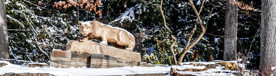 Photo of the Nittany Lion statue covered in snow