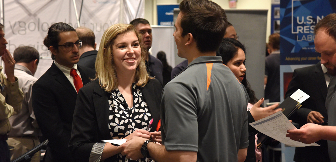 image of employer and student talking at a career fair